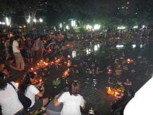 Loy Krathongs lit with candles floating on the lake