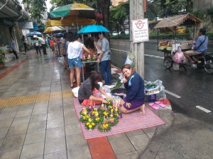 Vendors on the street selling Loy Krathongs