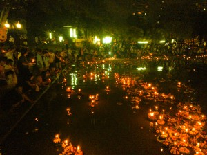 Candles on the Loy Krathongs lighting up the lake