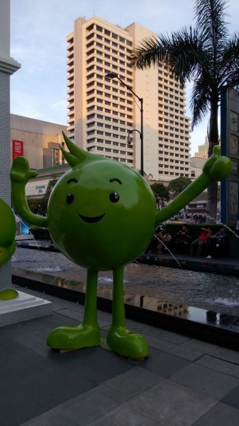 This is the mascot for my cell phone company, AIS.  Love his little tuft of hair.