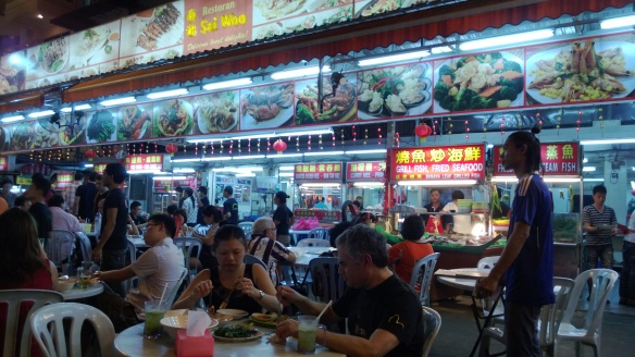 Street hawker food stall, with all the dishes shown at the top in giant pictures for easy ordering.