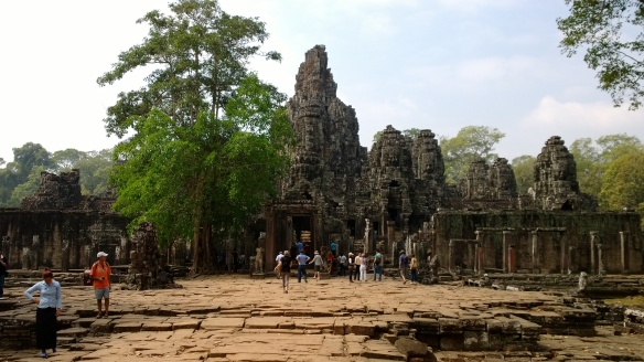 Entering Bayon temple at Angkor Thom.