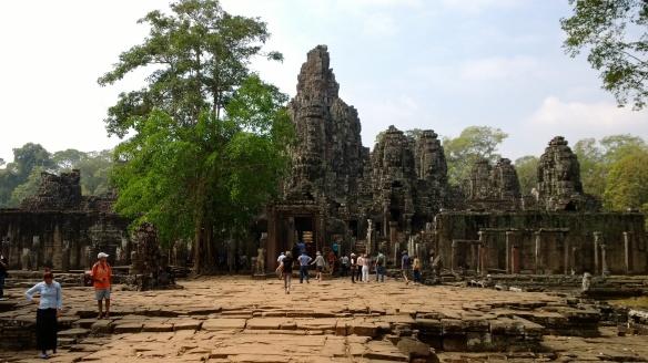 Entering Bayon temple at Angkor Thom.