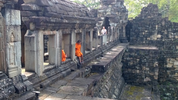Monks in saffron robes at Baphuon Temple