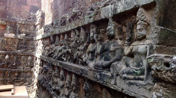 Wall of stone carvings.  Every image unique and different, but done with amazing precision.