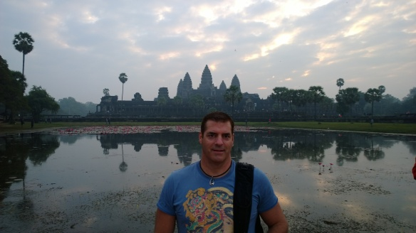 Me at Angkor Wat at sunrise, in front of the reflecting pond.  Even though it was a little cloudy that morning, it was still worth getting up at 4:30am to be at this incredible place for sunrise.