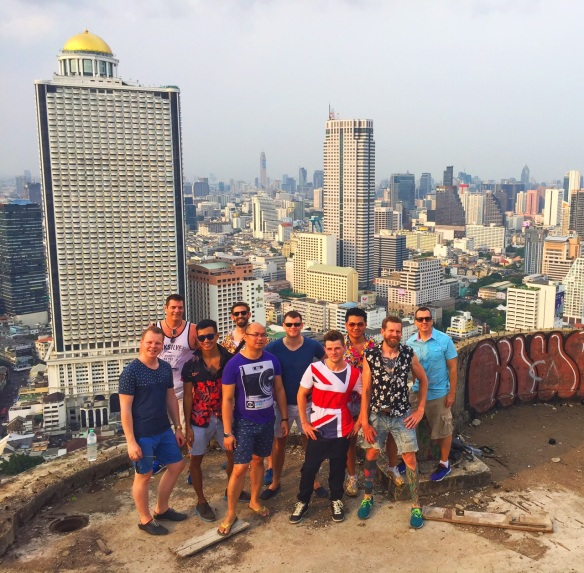 Me and friends that climbed to the roof.  The building behind us with the gold dome is the sister building, the State Tower/Lebua Hotel.