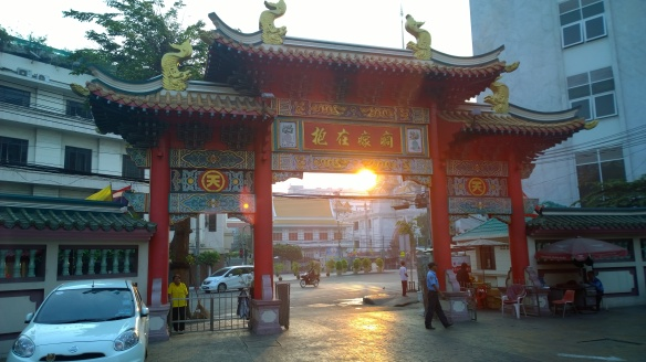 Gate to the Chinese temple, with the sunrise behind it