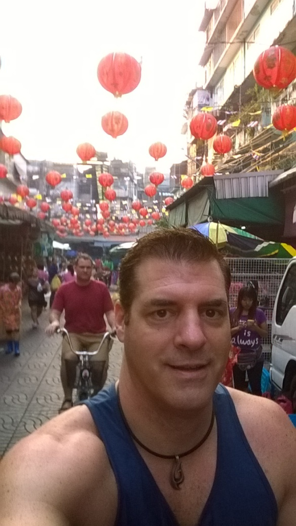 Riding through the Chinatown market