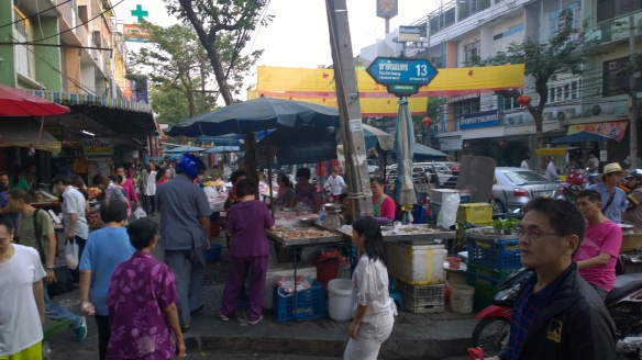 Streets in the market are busy at 7:30am on a Sunday morning