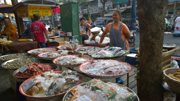 Vendor selling her fish, squid and other fresh food