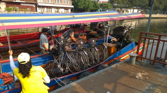 Loading the bikes onto the longtail boat for a cruise through the klongs