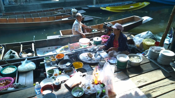 Women on boats cooking food