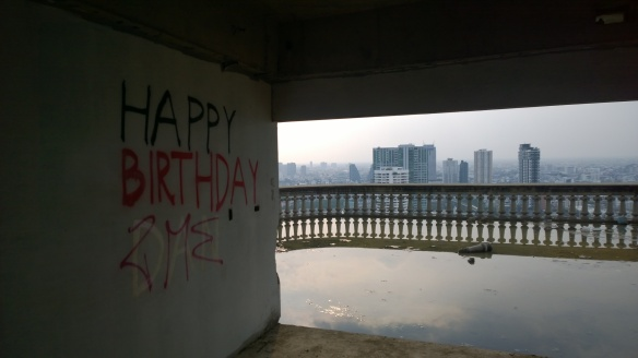 A little graffiti, a balcony filled with a rainwater pond, and beautiful view to the west.