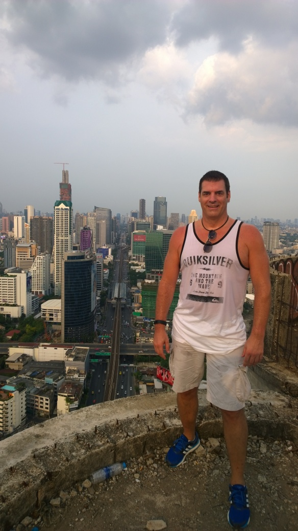 Me at the top and edge of the building, very sweaty after climbing 50 floors