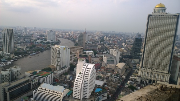 Looking at the Chao Phraya River, Shangri-La Hotel, and the State Tower/Lebua Hotel building with the gold dome.